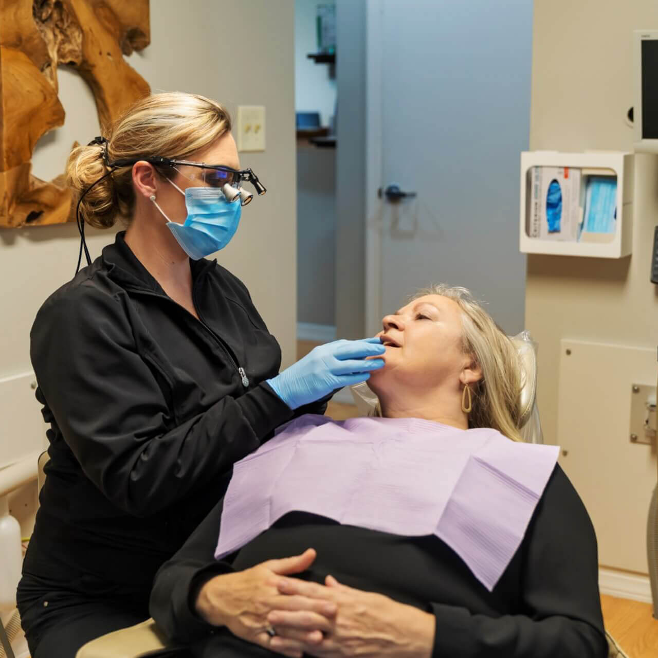 Our hygienist deep cleaning a patient's gums to prevent periodontal disease