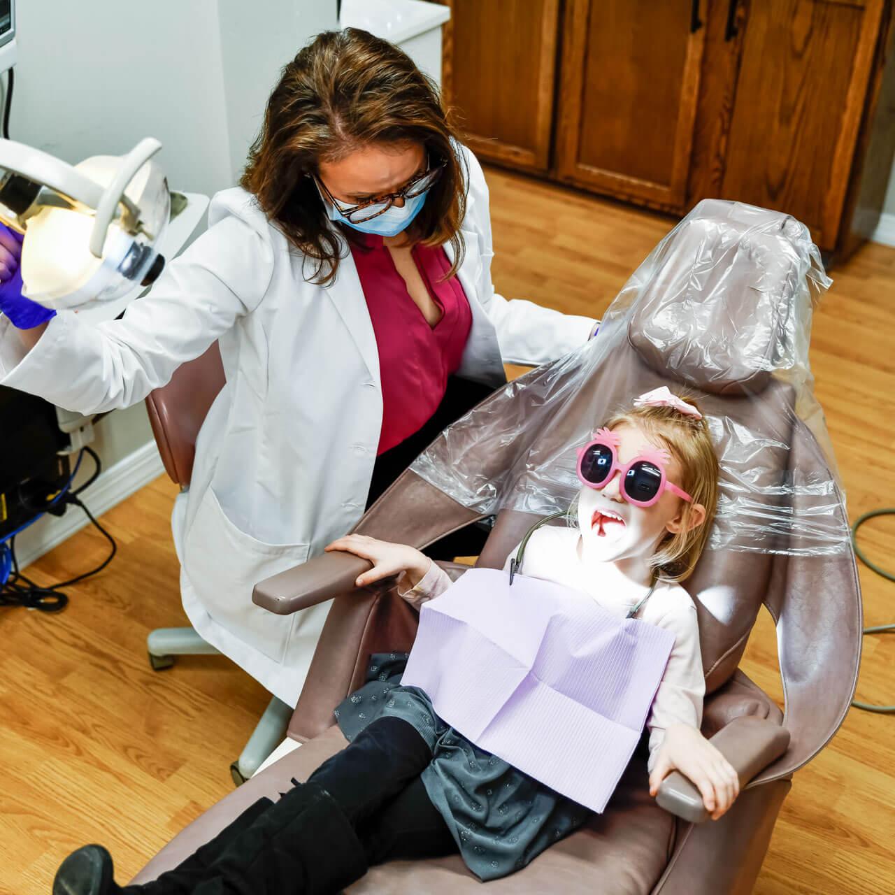 Dr Megan prepares to restore a child's smile