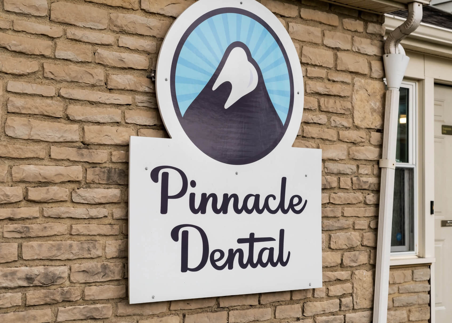Look for the Pinnacle Dental sign at our building in Grove City