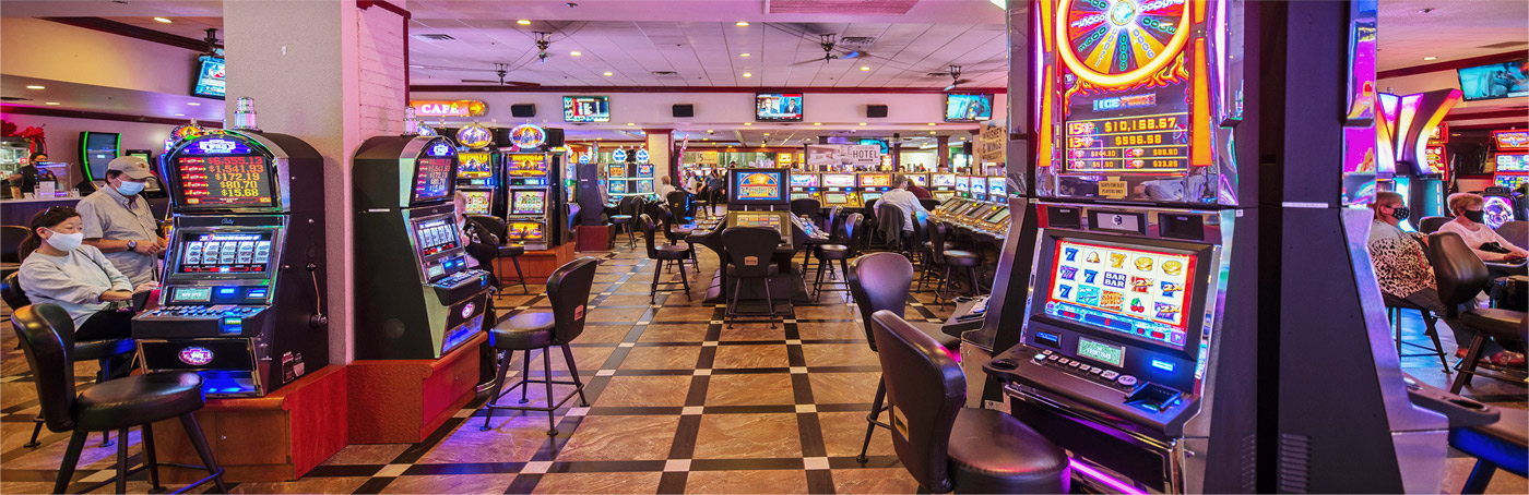 Ellis Island Casino Floor with SLot Machines and tables