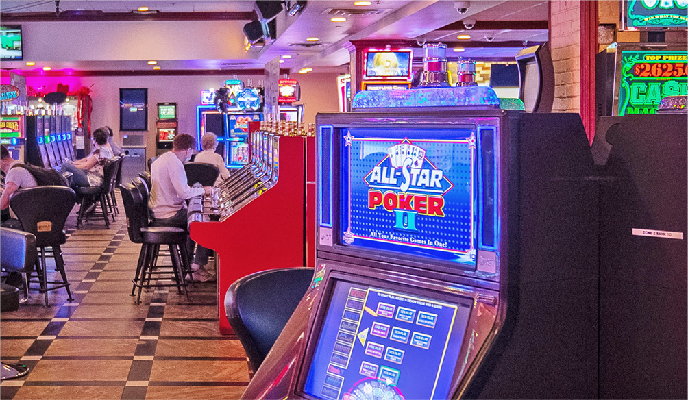 Ellis Island Casino slot machine and players on devices