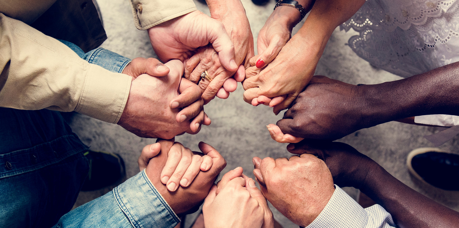 Group holding hands in support