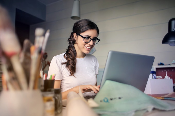 A freelancer working on behalf of a small business as a way to save money