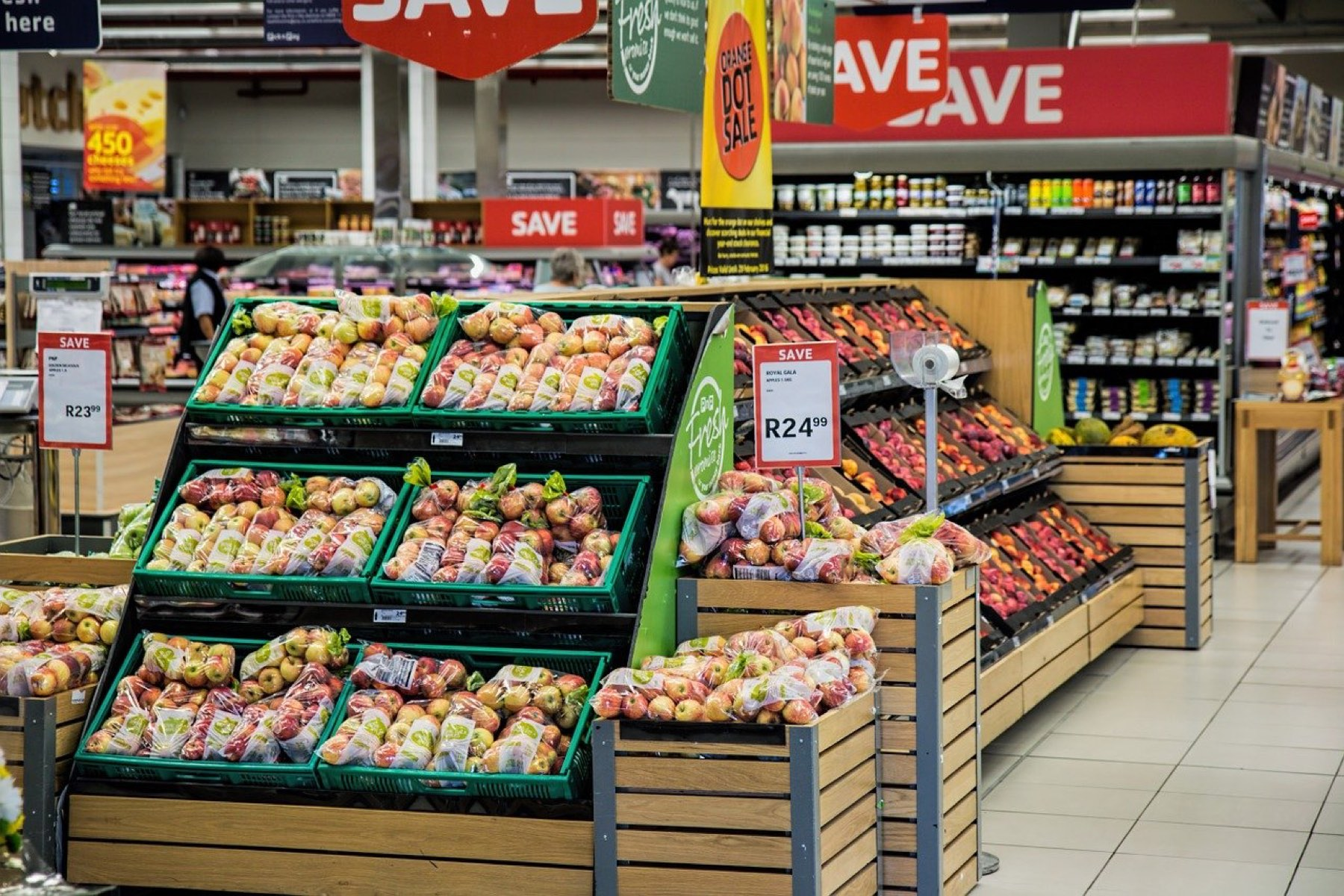 Photo of interior of grocery store showing fruit and other food products.