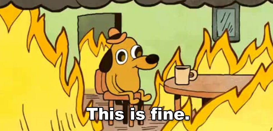 A cartoon dog sitting in a room on fire