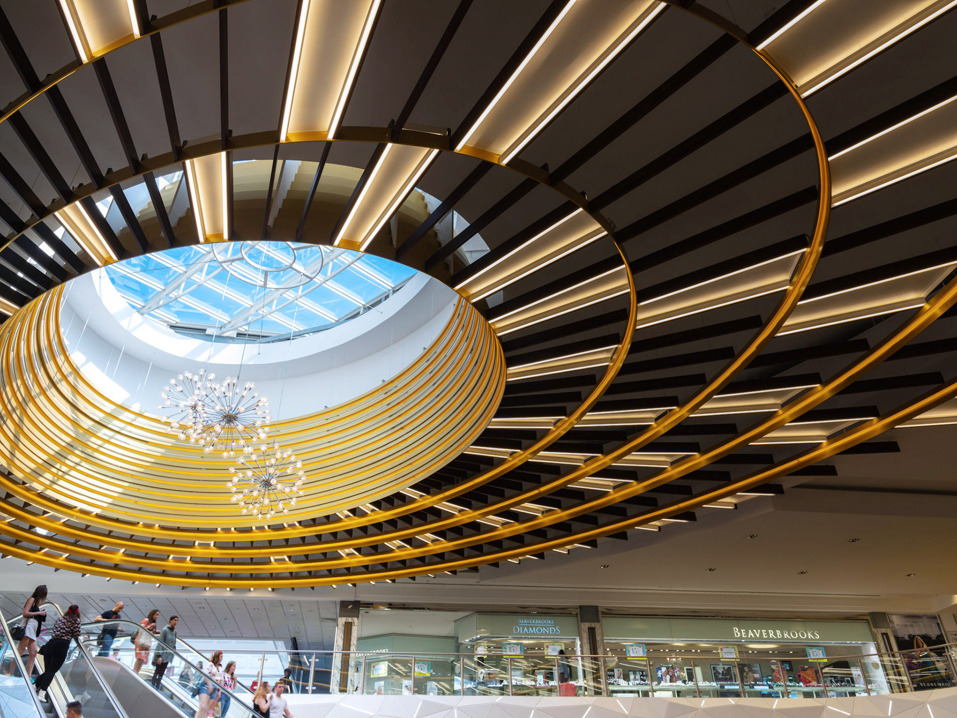 Architectural Photography Exchange Court in Manchester Arndale New Roof. Circular with gold and blue sky