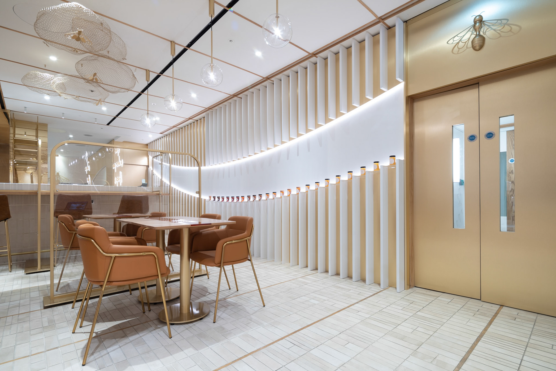 Retail Photography Restaurant Hive Interior with gold door at Selfridges in London