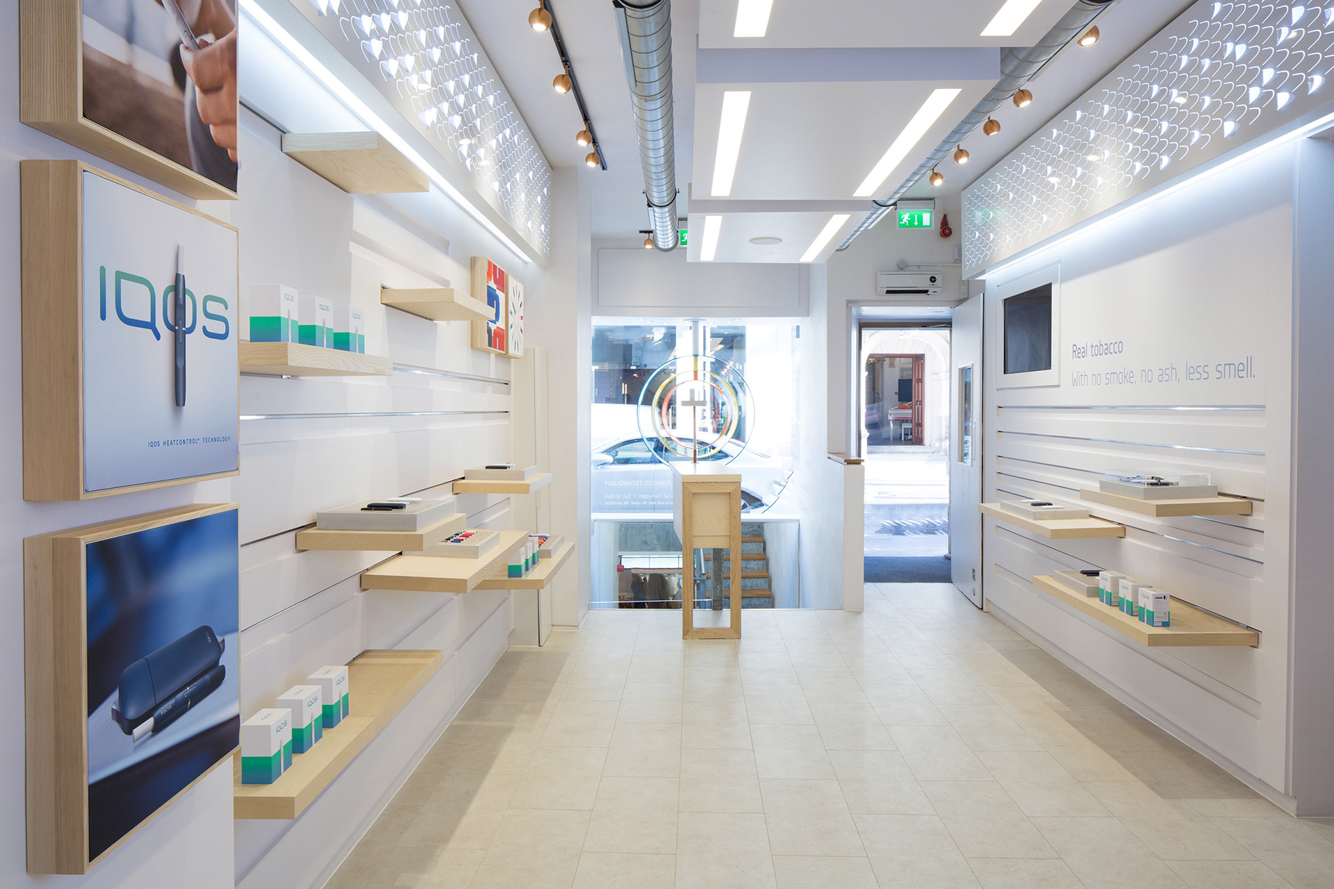 Architectural Interiors at IQOS Store in Soho looking outside