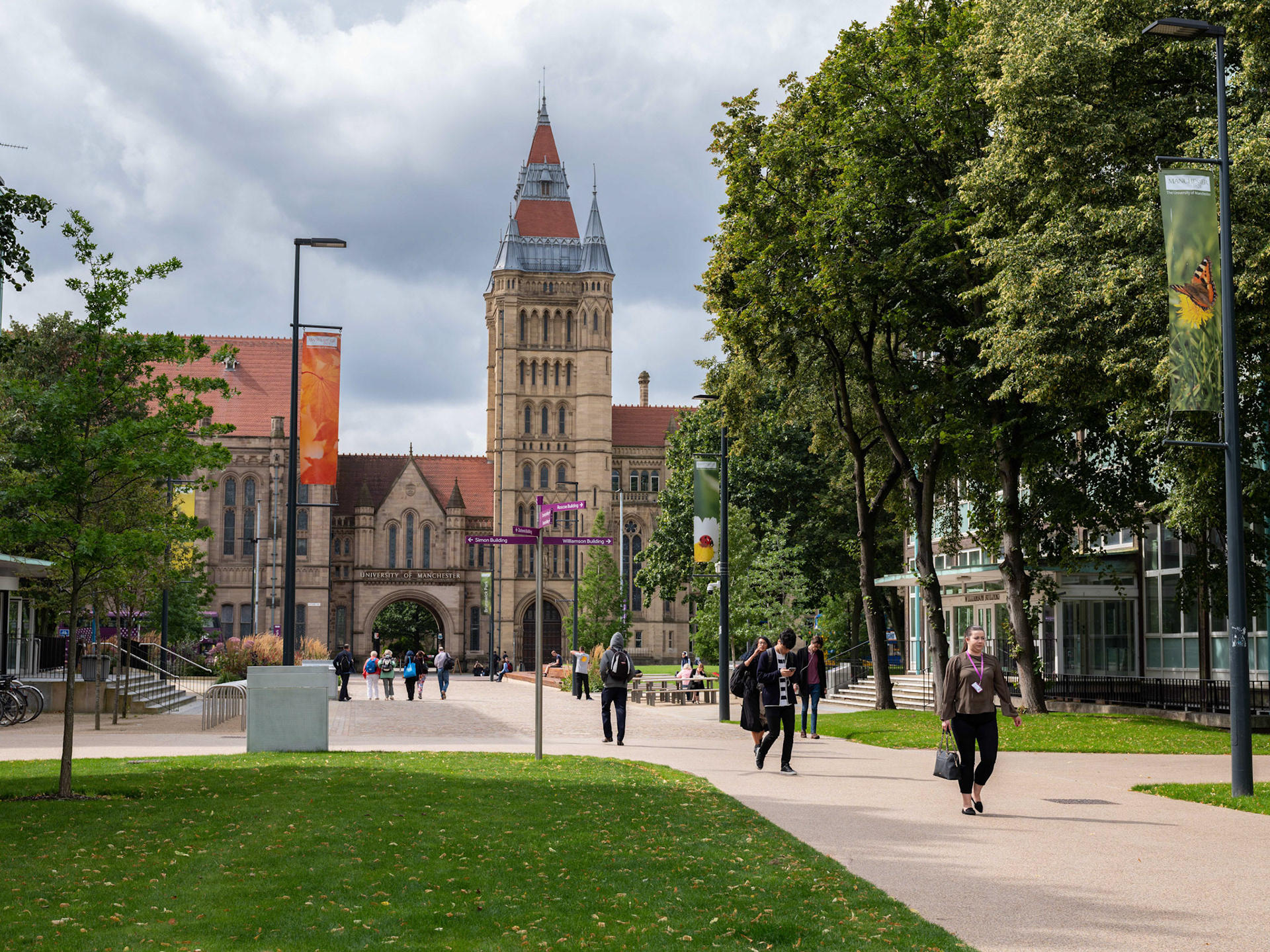 Commercial Photography University of Manchester Campus with students walking through with background of the main tower on a sunny day
