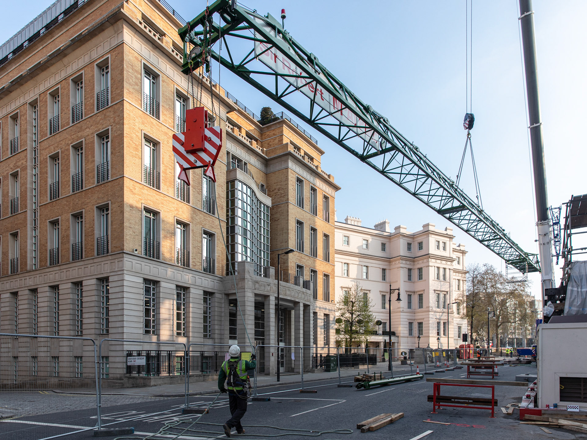 Commercial Photography at Industrial Tower Cranes crane gets lifted into place in central London