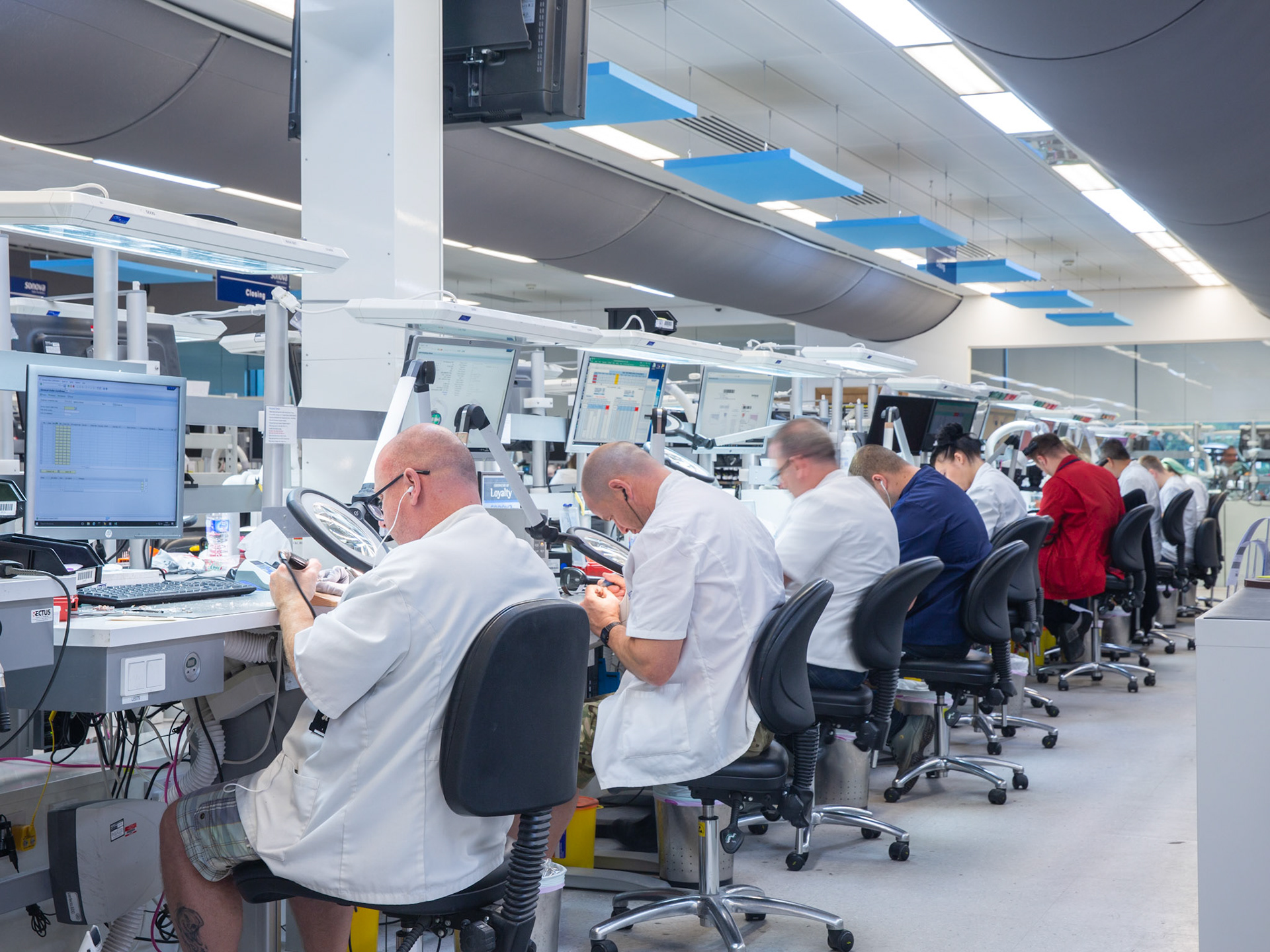 Commercial Photography Hearing Aid Production line in laboratory