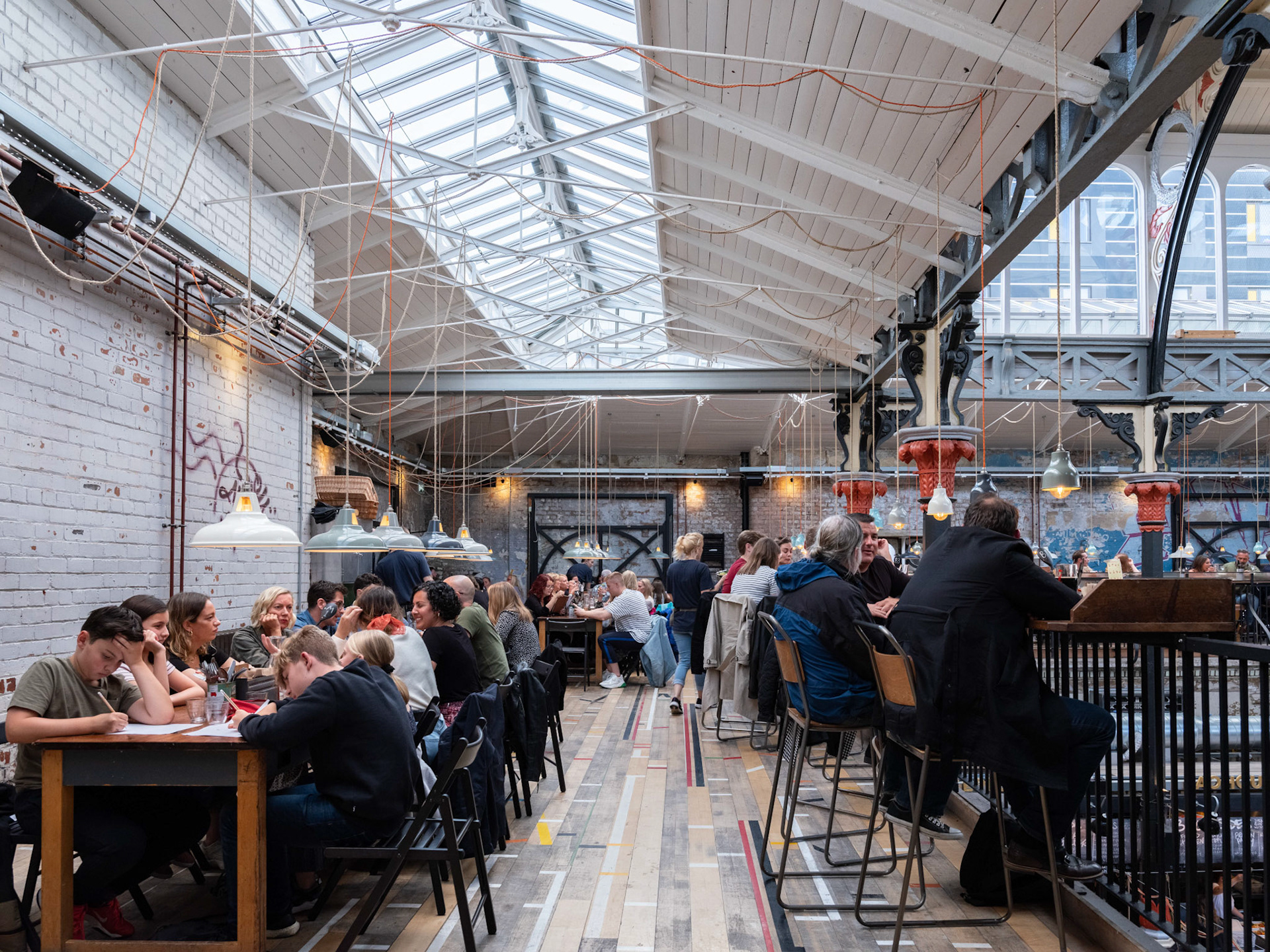 Architectural Photography Mackie Mayor irestaurant inside upstairs with people sat at tables