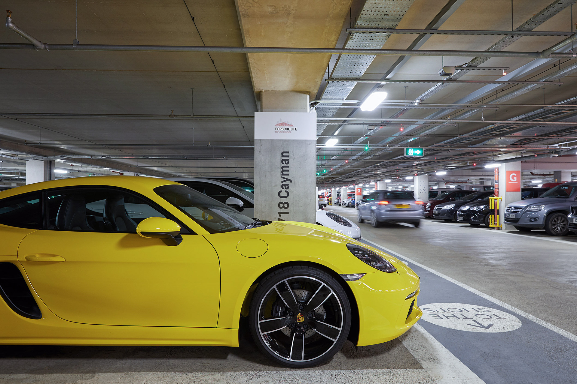 Retail Photography Porsche Store Oxford yellow car in car park waiting for people to arrive for drive away experience