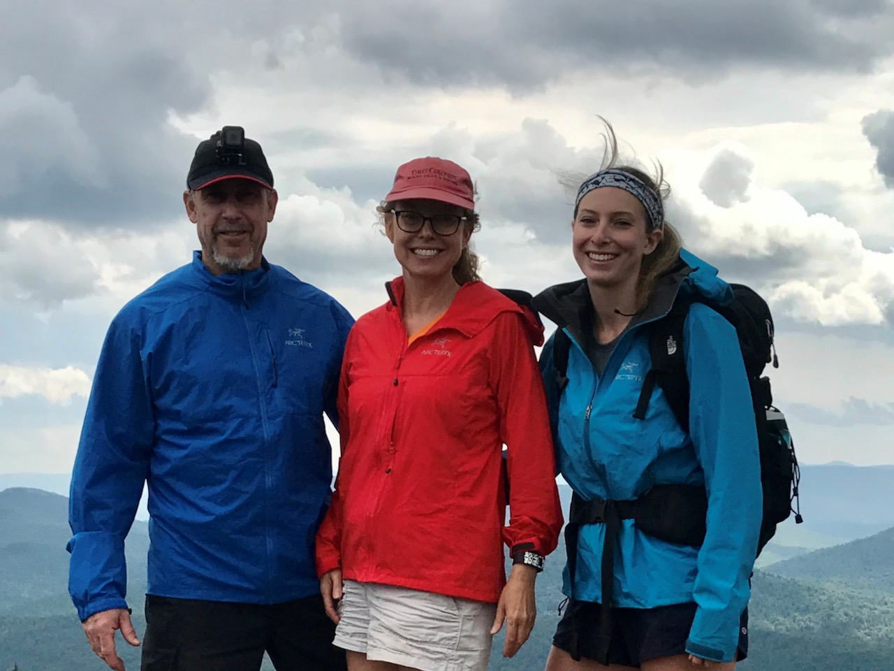 Image of three people in outdoor clothing posing for a photo