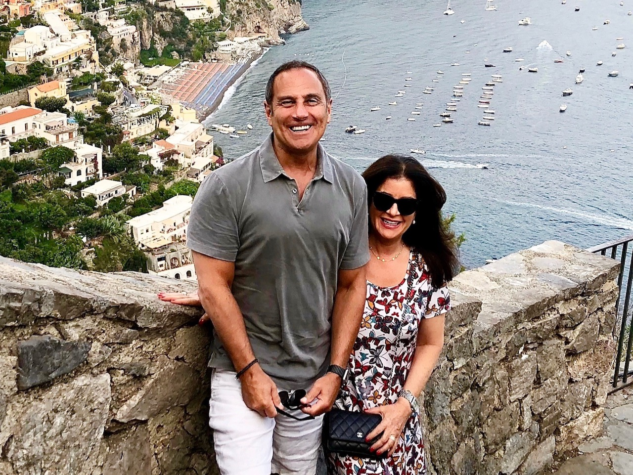 Image of couple posing for photo at a viewpoint in italy