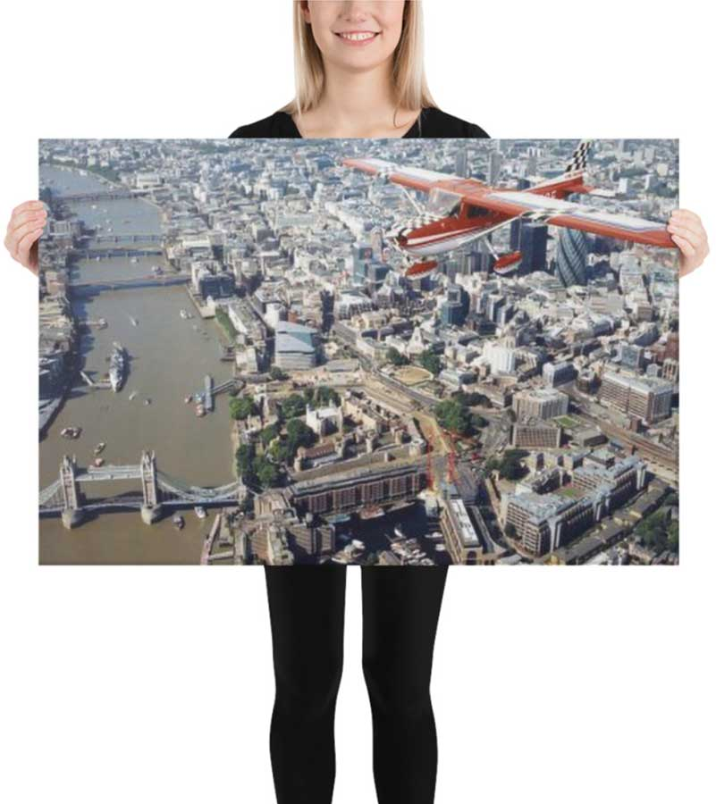 Image showing a marketing example. Girl holding canvas print.
