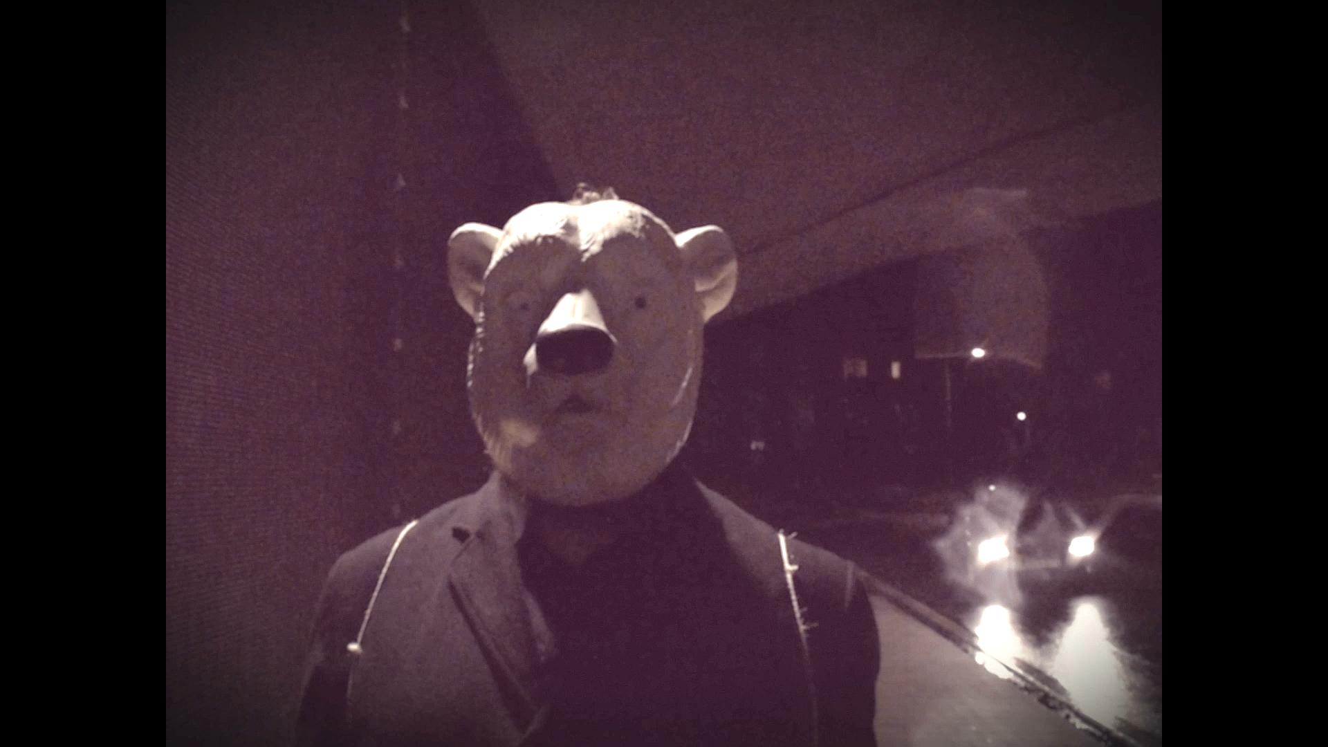 Video Snapshot with a man wearing a polar bear mask