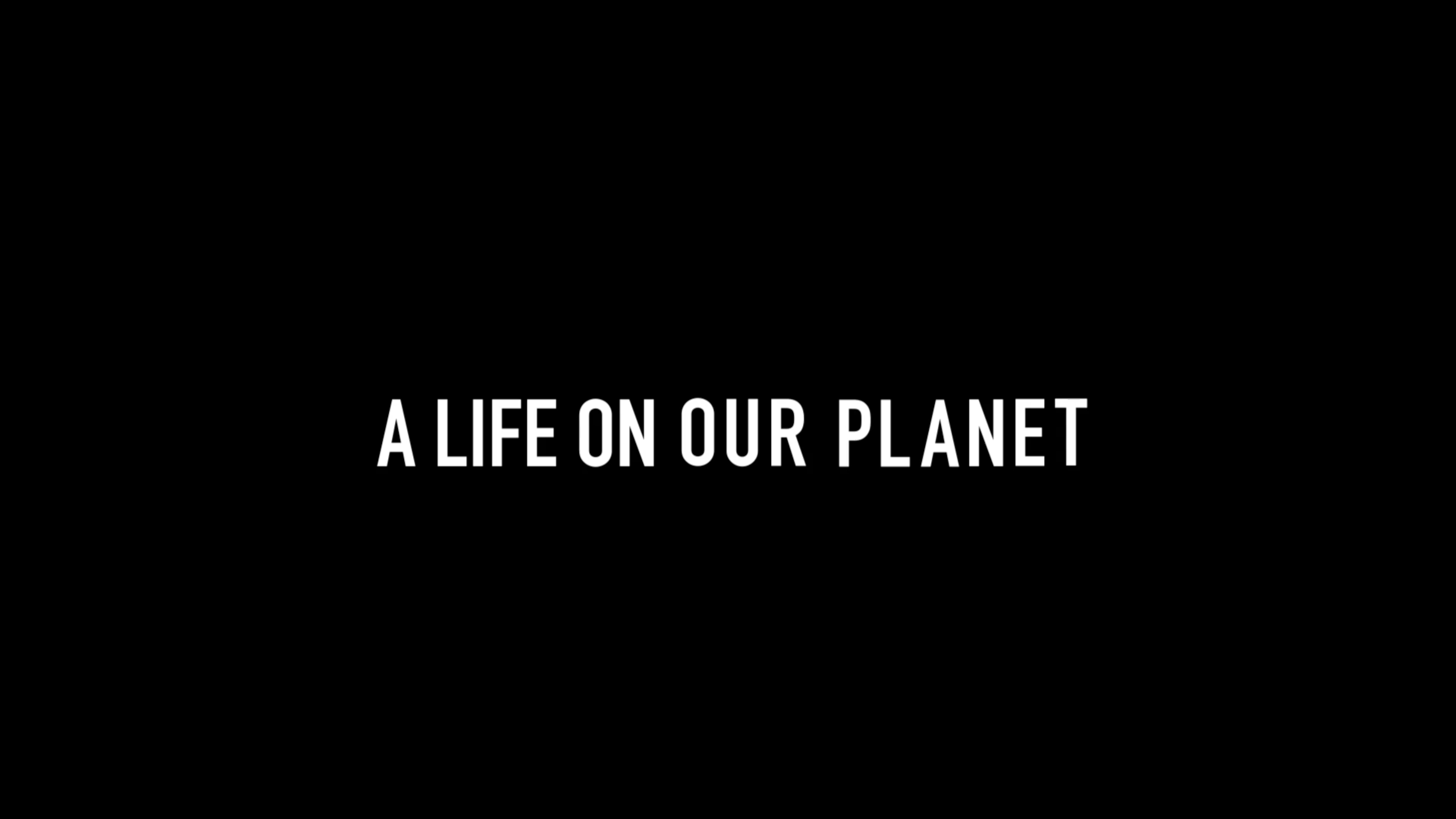 """""""A Life on Our Planet"""" in bold white text on a black background."""