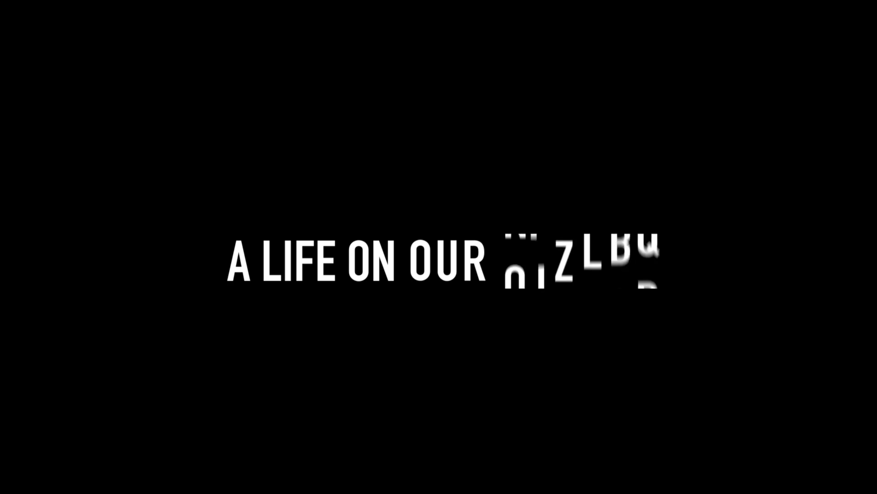 """""""A Life on The Earth"""" in bold white text on a black background."""