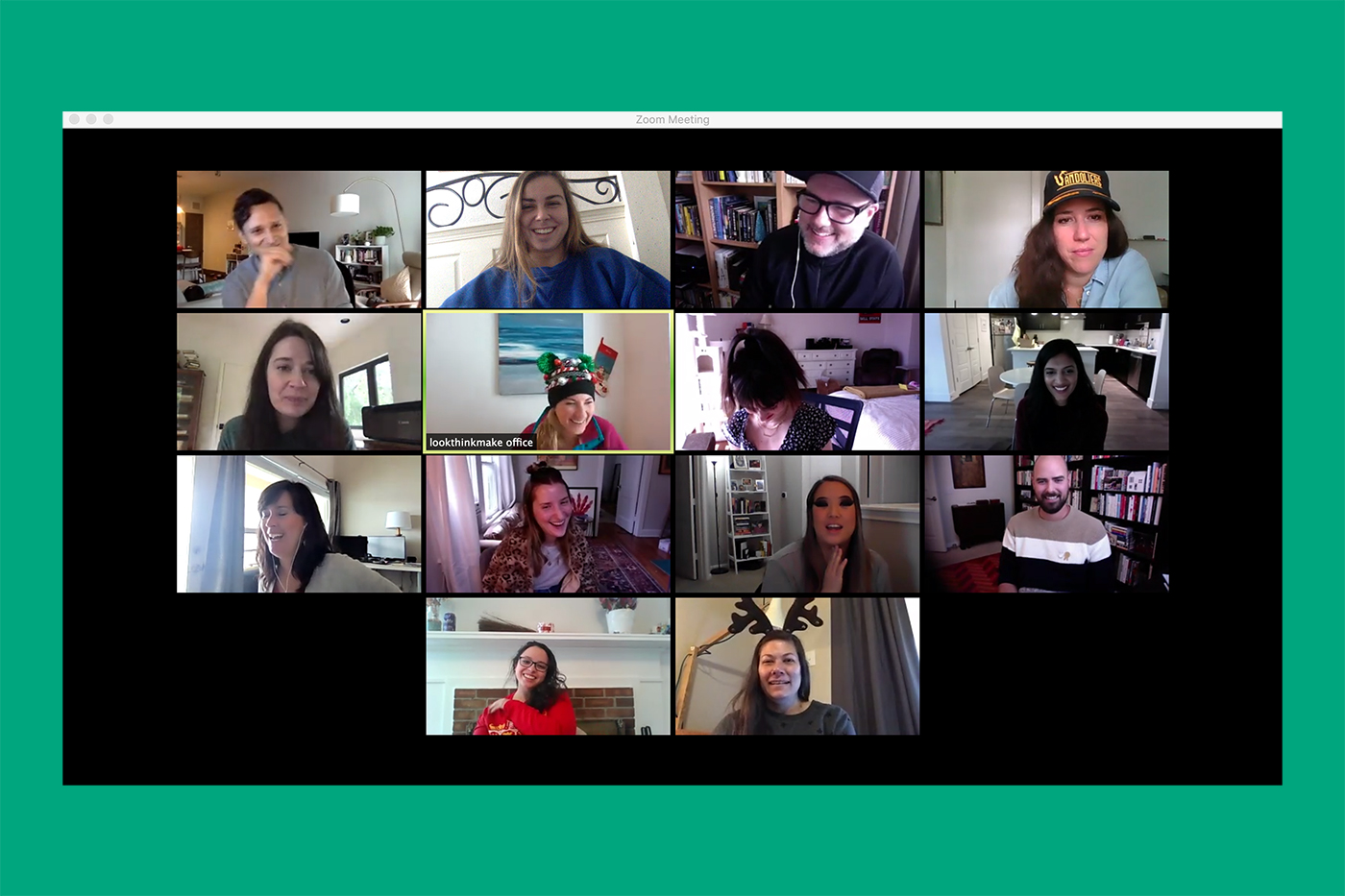 A large group of lookthinkmake employees gathered on Zoom and laughing on their screens.