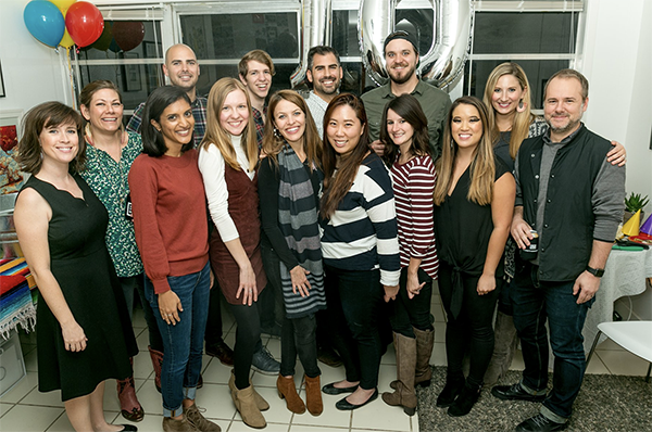The lookthinkmake team smiling together during a holiday party.