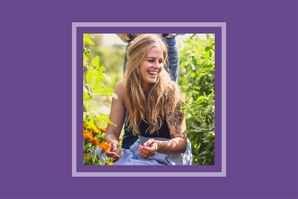 Taylor Burge laughing in a garden.