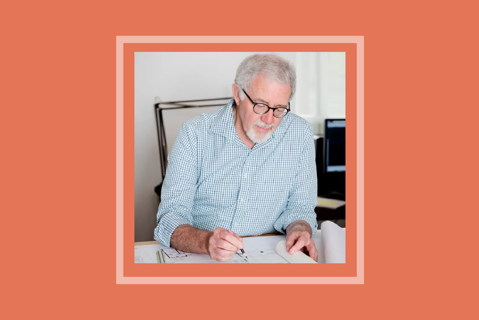 Charles Travis sketching at his desk.