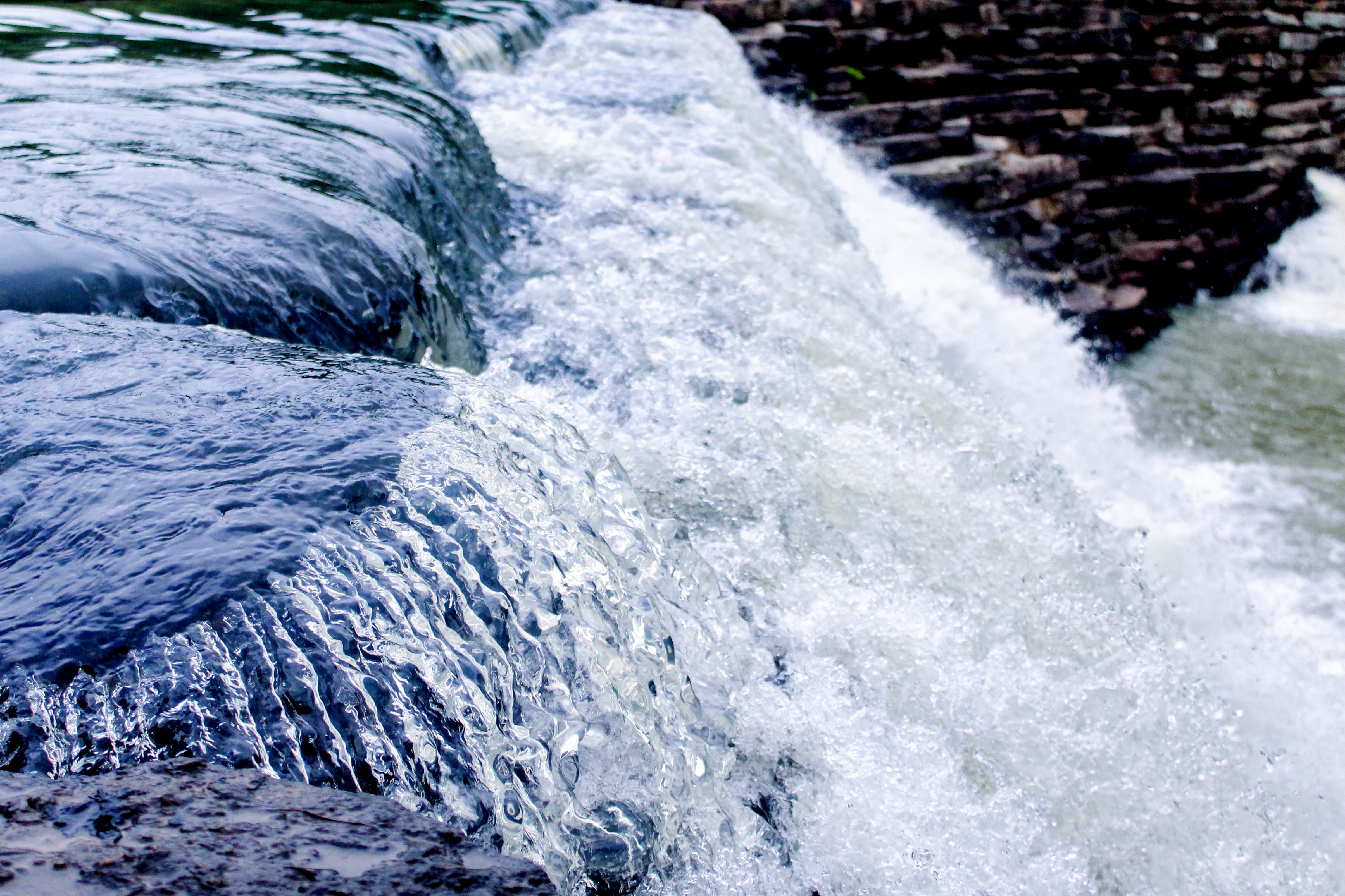 An abstract image of power: a strong, flowing current of water.
