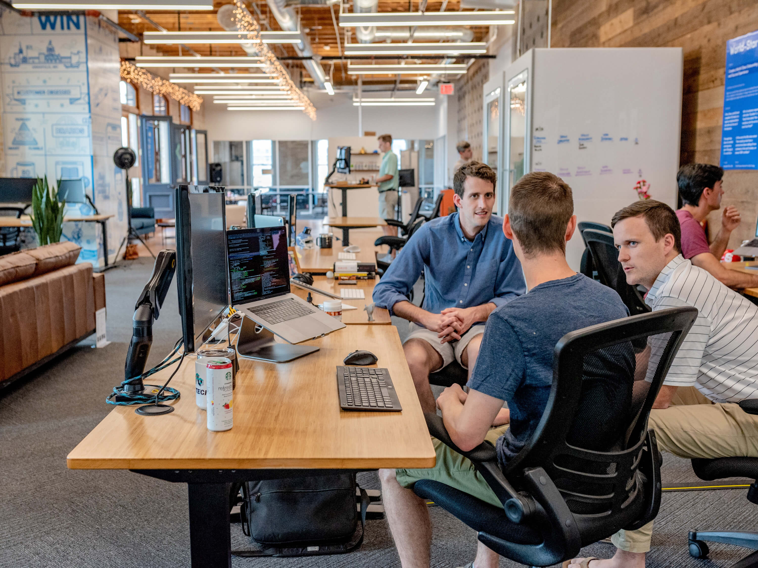 Three software developers talking in an office