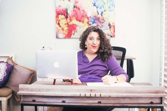 Kara sitting at her desk.