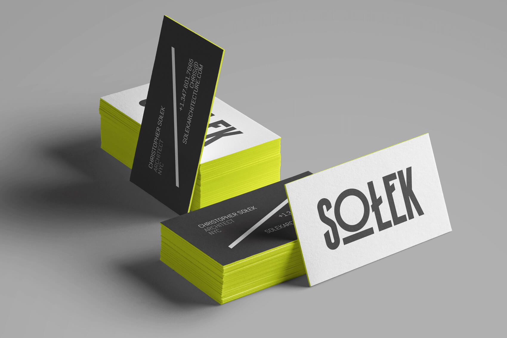 Solek Architecture business cards designed a color punch neon yellow edge.
