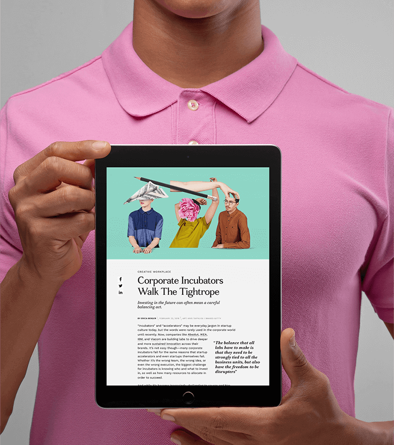 Gent in pink polo shirt is holding tablet displaying abstract editorial artwork and article.
