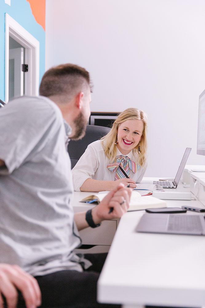 Wes and Tera at desk