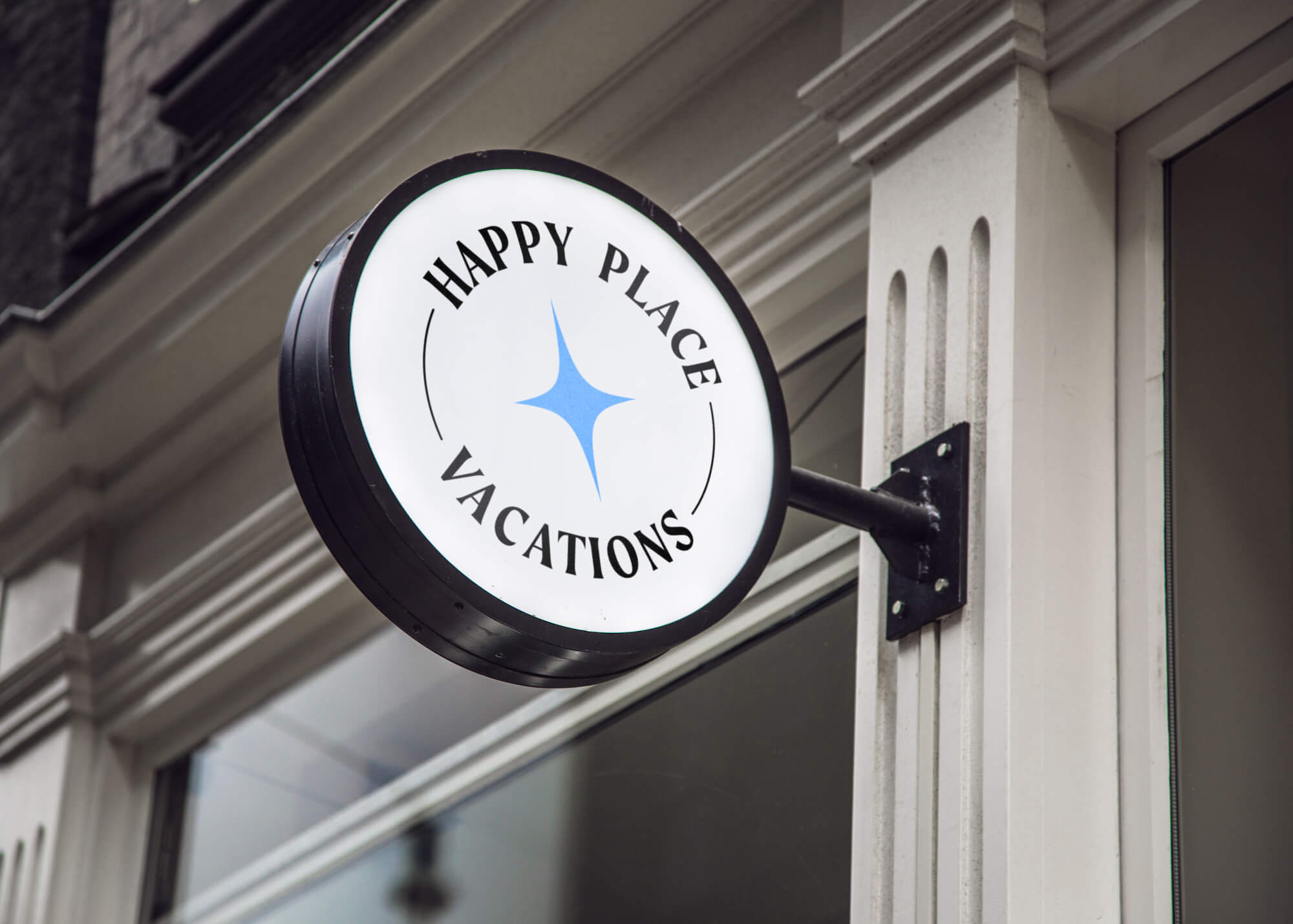 Circular sign holding the Happy Place Vacations logo