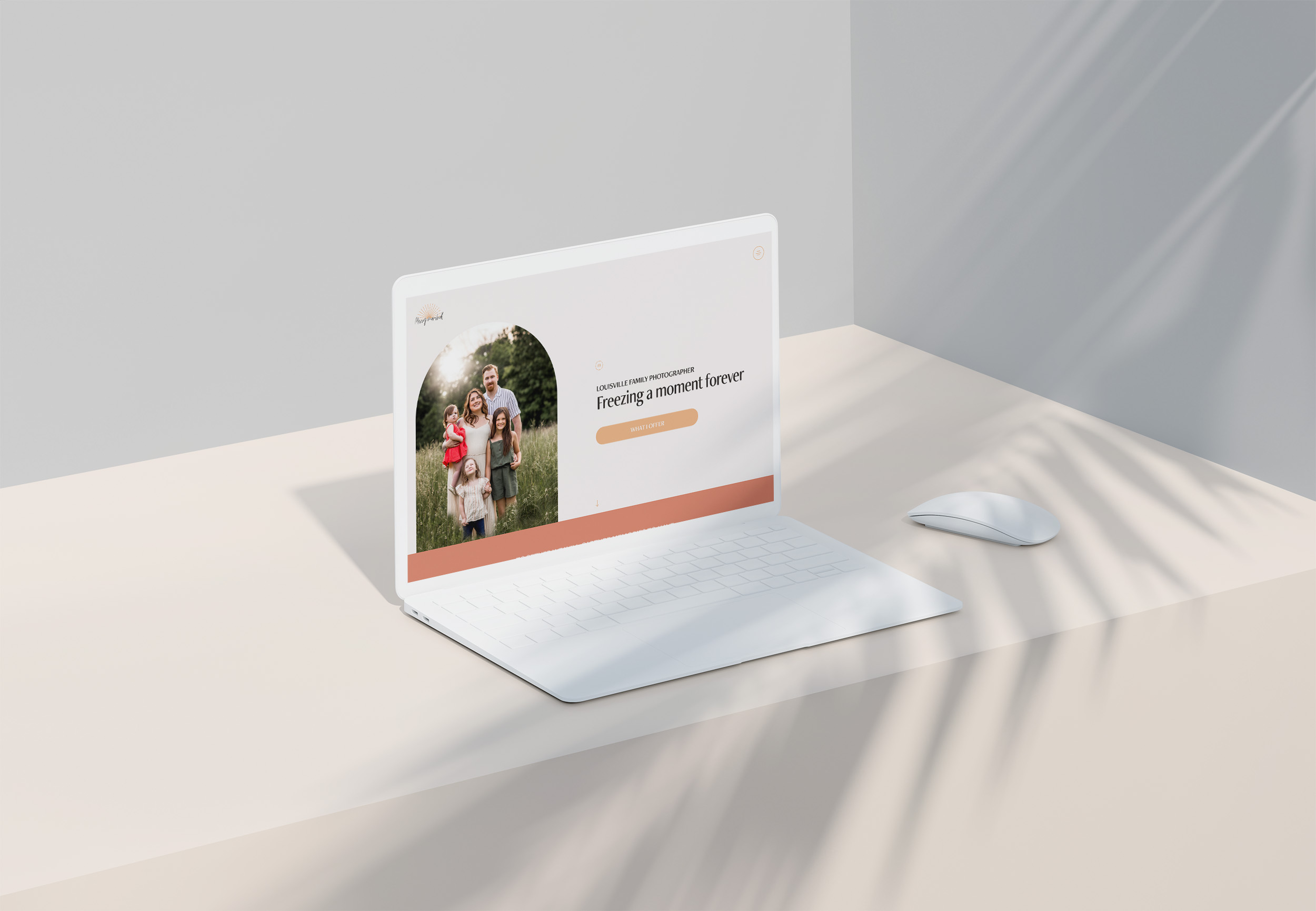 A laptop sitting on a desk with the Missy Marshall Photography website displayed