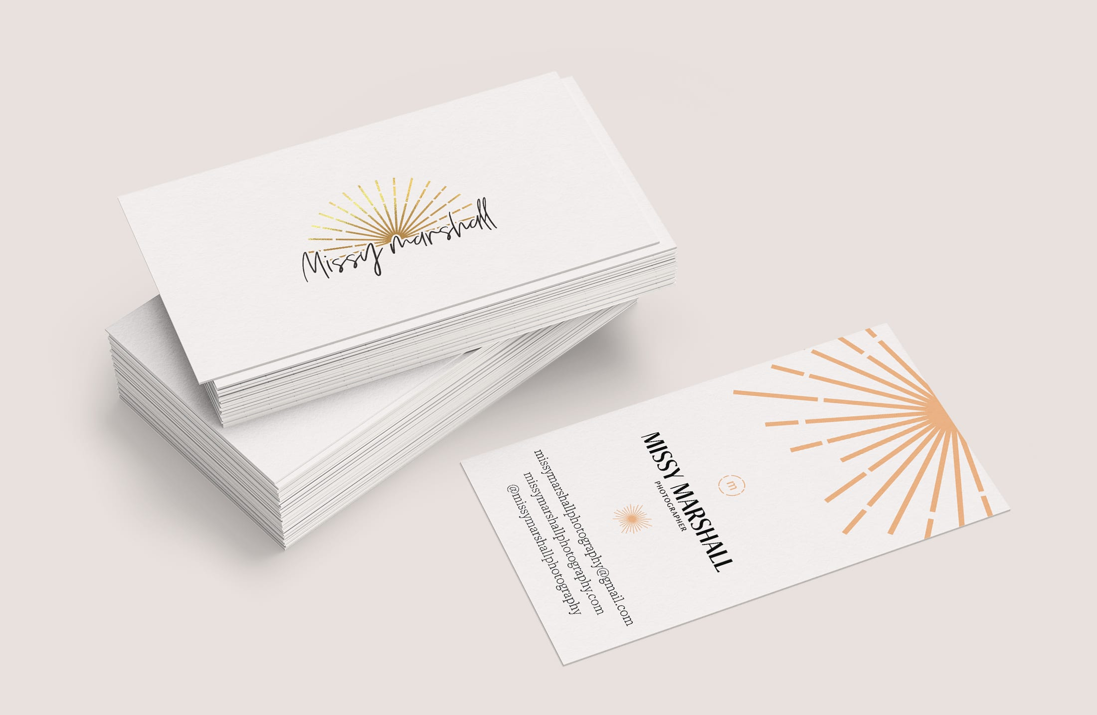 A stack of business cards displaying the Missy Marshall Photography logo and information on Missy Marshall