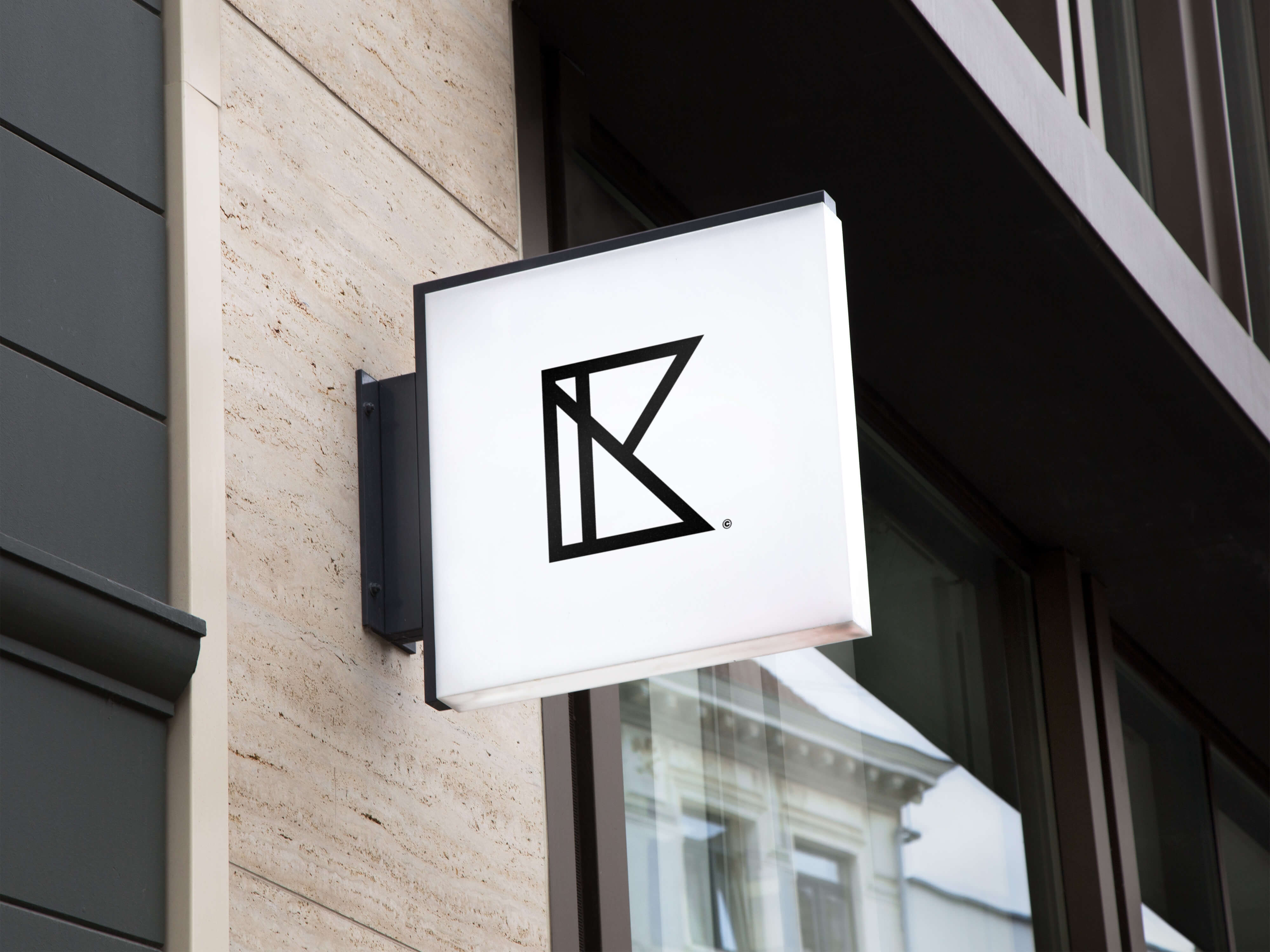 A white sign on a building with the Iverson and Kaine logo