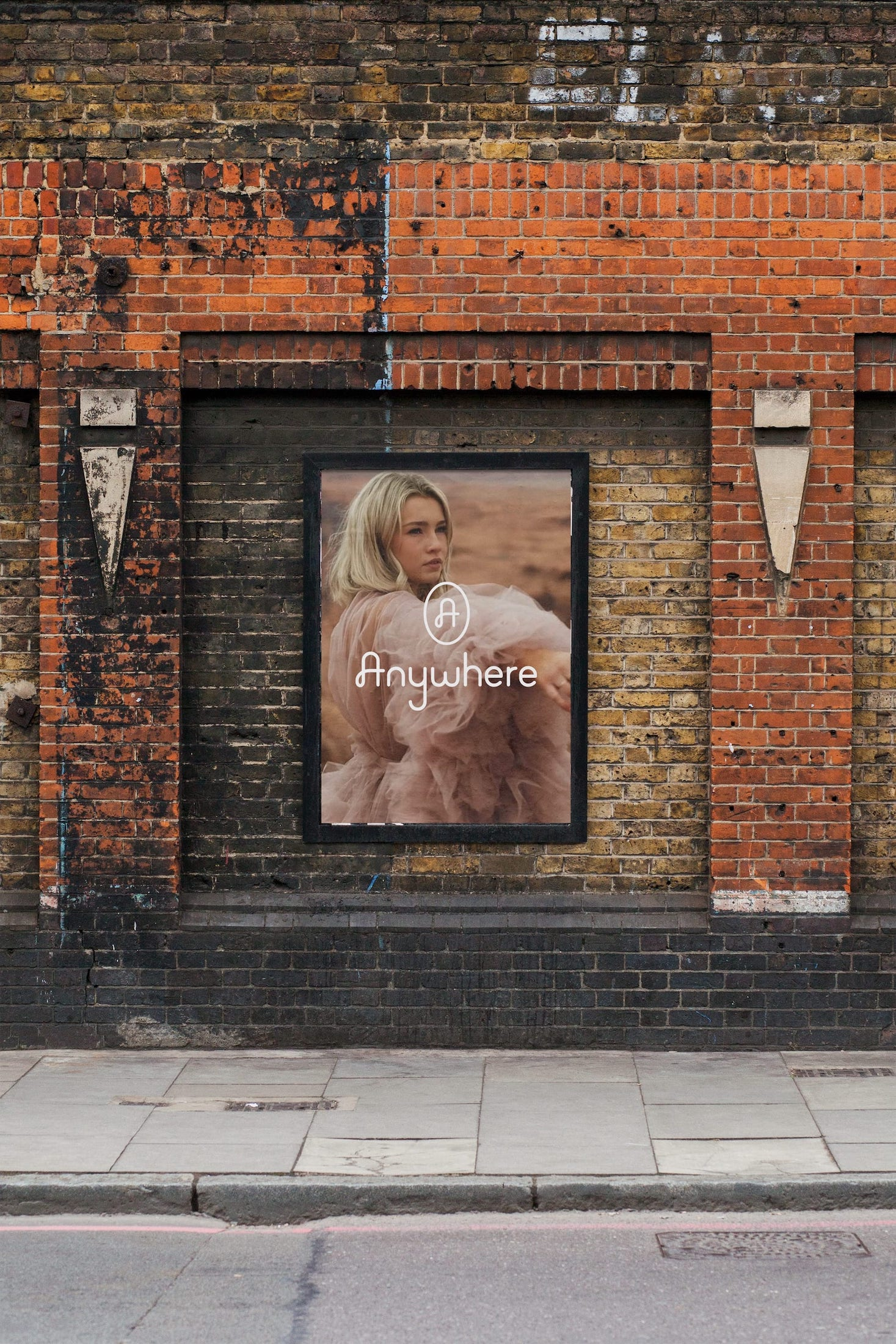 A billboard for Anywhere Films on a brick wall