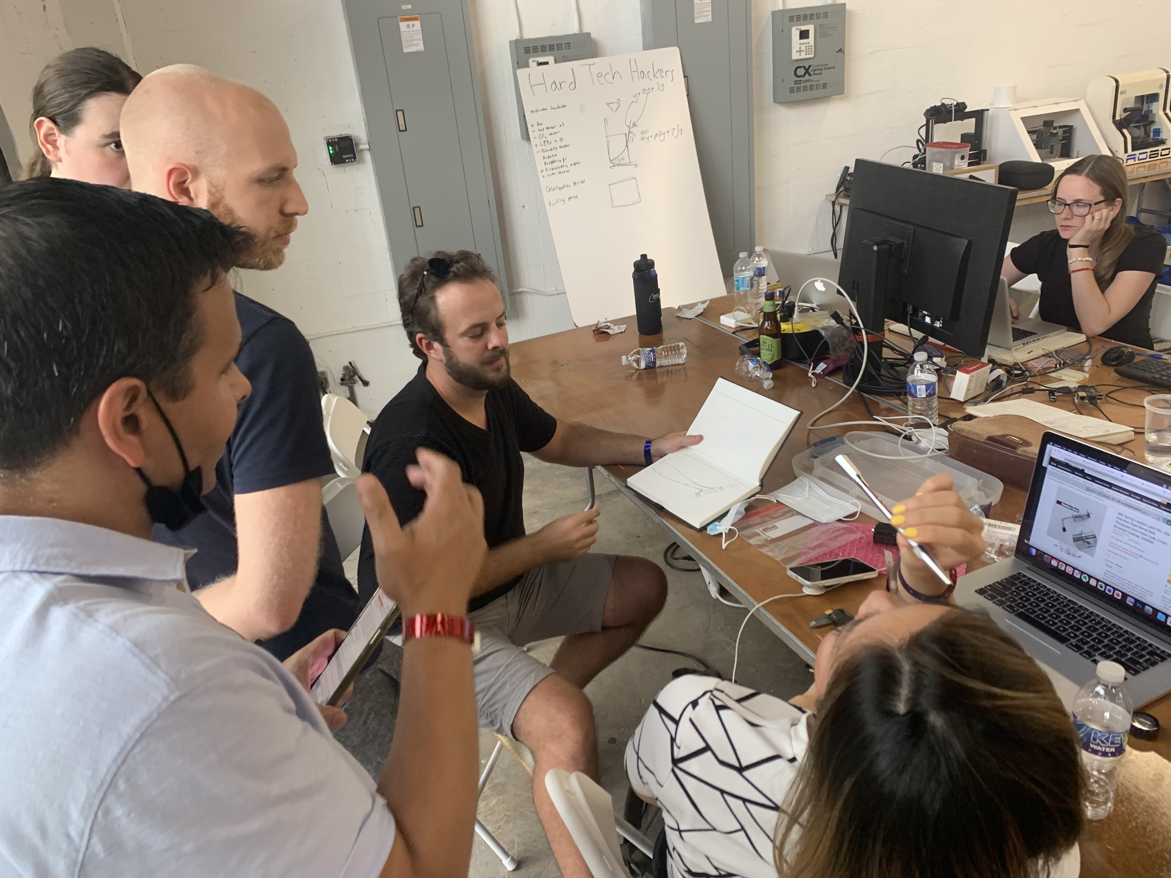 Hard Tech Miami members brainstorming ways to approach building a project