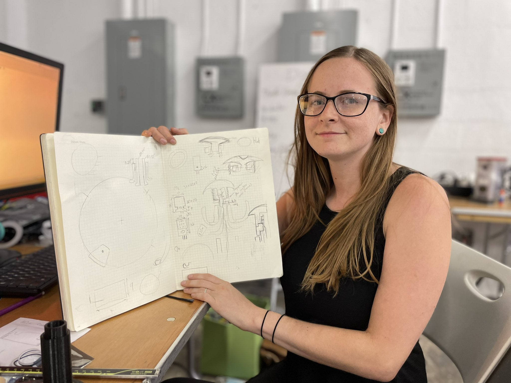 One of our members posing with design notes