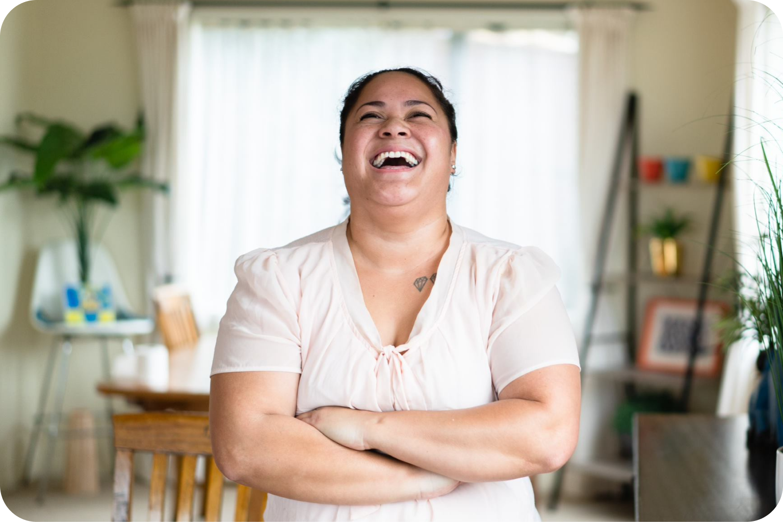 Woman in white shirt laughing