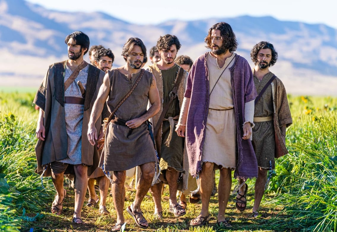 """Cover for """"The Chosen"""". It shows Jesus and his apostles walking down a path in the country side"""