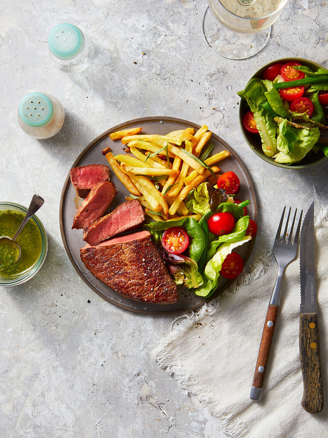 Fillet Steak Served with rosemary french fries and summer salad