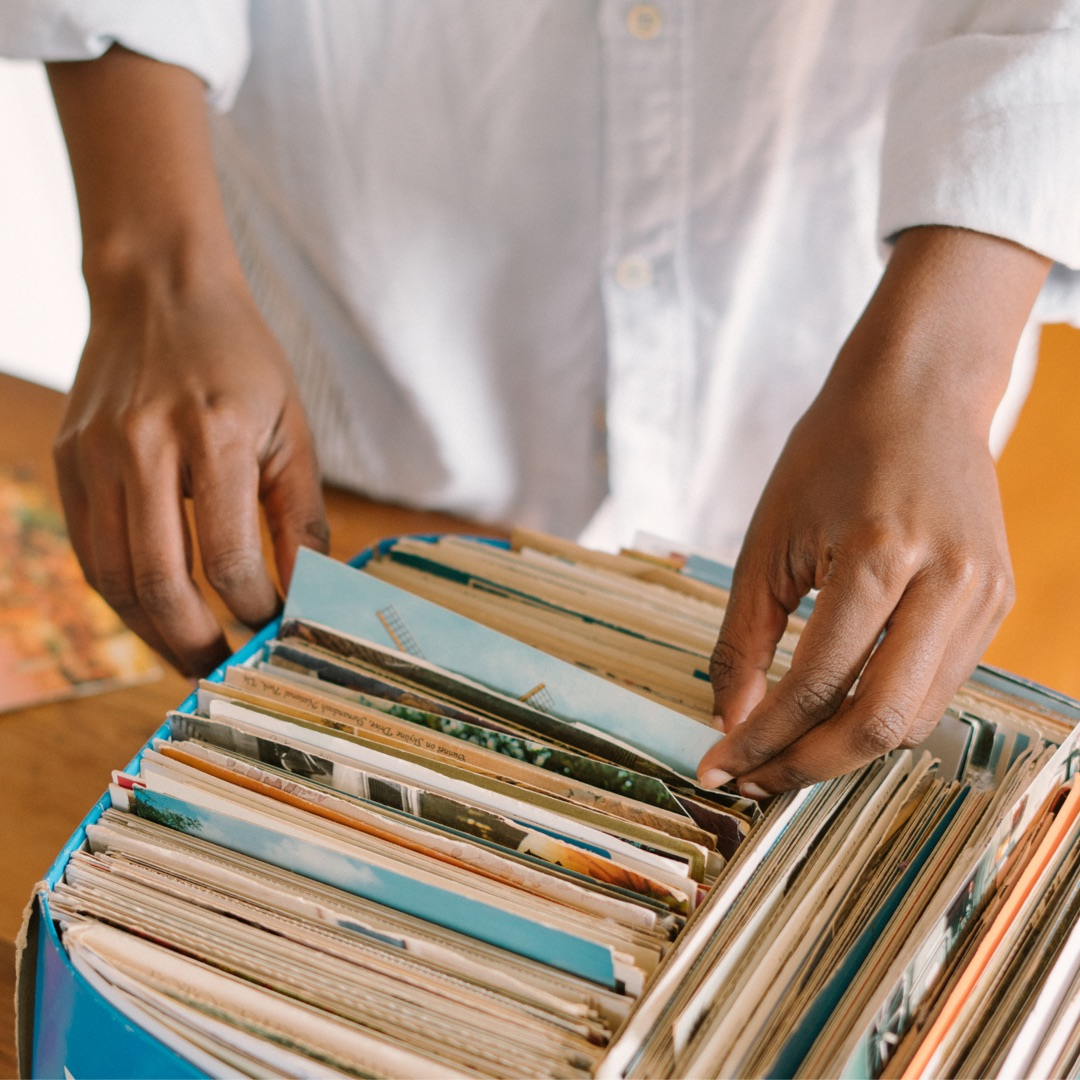 A man sorting through folders with private photos