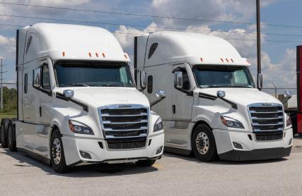 Two Semi Tractor Trailer Trucks