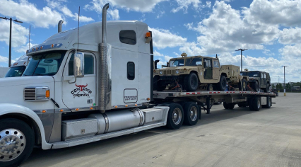 truck transporting us army humvees