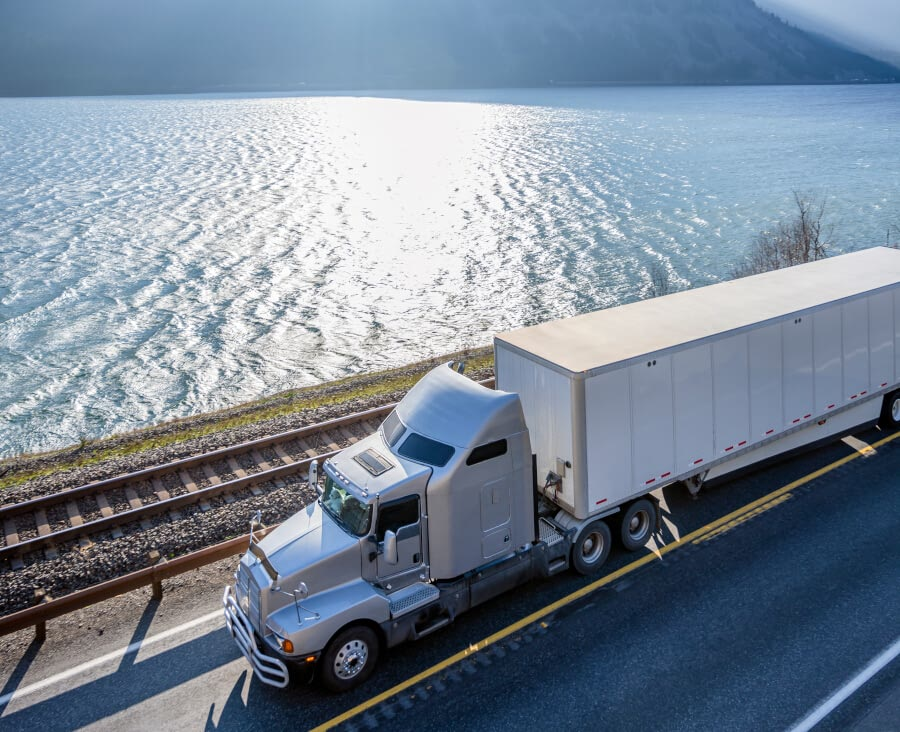 Freight truck rides across sea and rail.