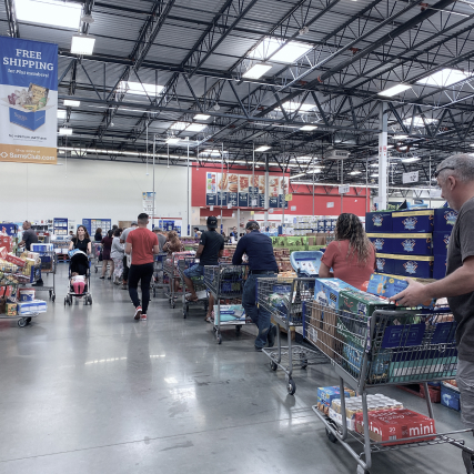 queue of people with carts