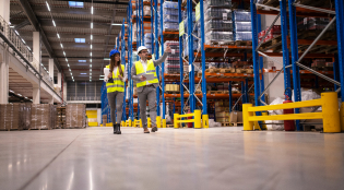Warehouse managers walking in a large storage department