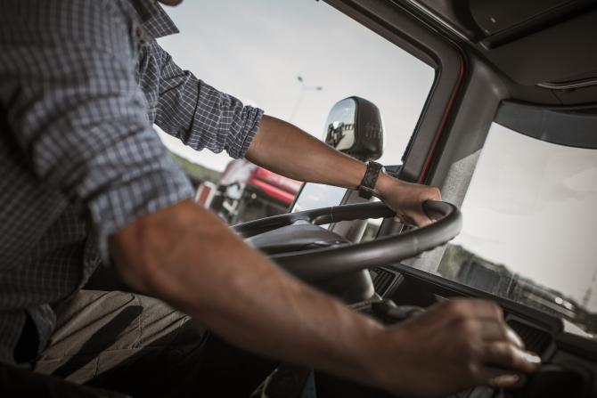 man behind the Wheel.